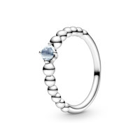 Sterling silver ring with treated aqua blue topaz